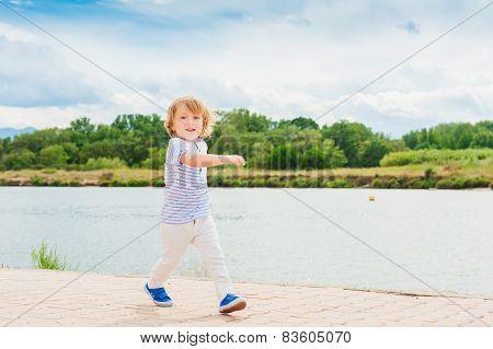 Adorable little boy having fun outdoors