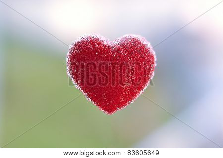 Red heart with bubbles floating in the air
