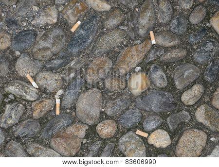 Cigarette stubs on ground