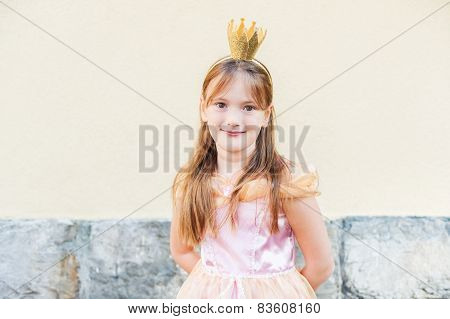 Outdoor portrait of a cute little princess