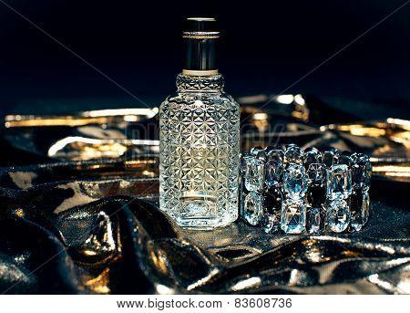 Perfume Bottle On Golden Background