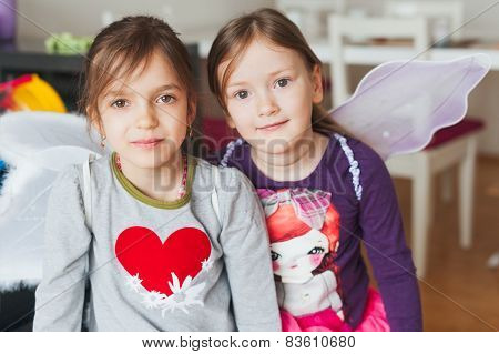 Two adorable little girls playing at home