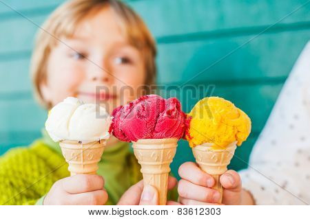 Three corn of ice cream holding by hands of mother and two kids