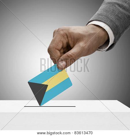 Black Male Holding Flag. Voting Concept - Bahamas