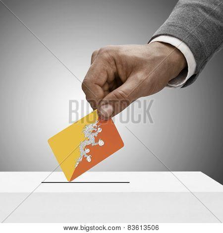 Black Male Holding Flag. Voting Concept - Bhutan