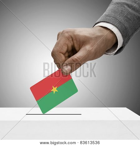 Black Male Holding Flag. Voting Concept - Burkina Faso
