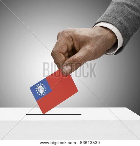 Black Male Holding Flag. Voting Concept - Burma