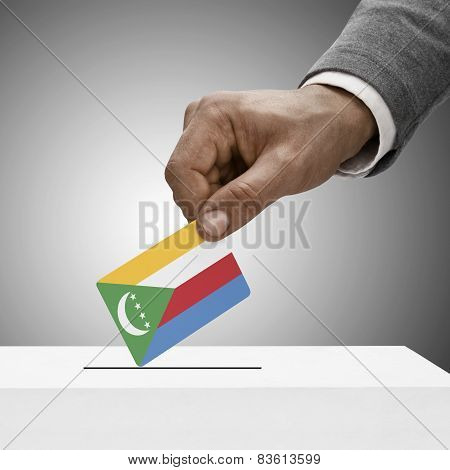 Black Male Holding Flag. Voting Concept - Comoros