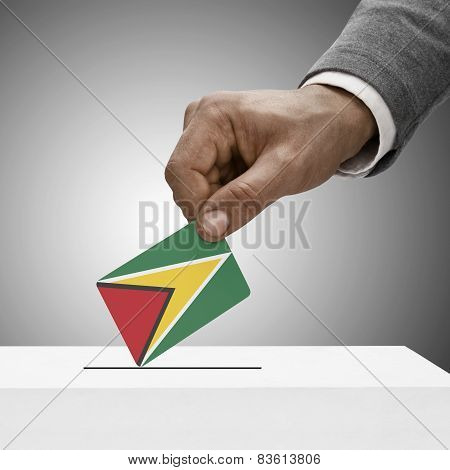 Black Male Holding Flag. Voting Concept - Guyana