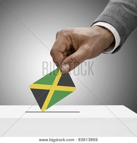Black Male Holding Flag. Voting Concept - Jamaica
