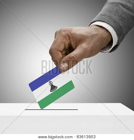 Black Male Holding Flag. Voting Concept - Lesotho
