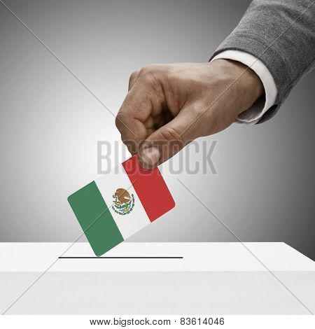 Black Male Holding Flag. Voting Concept - Mexico