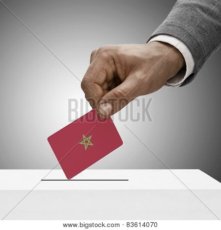 Black Male Holding Flag. Voting Concept - Morocco