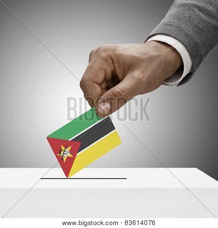 Black Male Holding Flag. Voting Concept - Mozambique