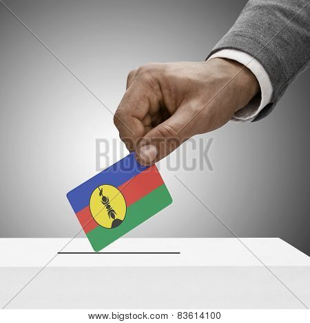 Black Male Holding Flag. Voting Concept - New Caledonia