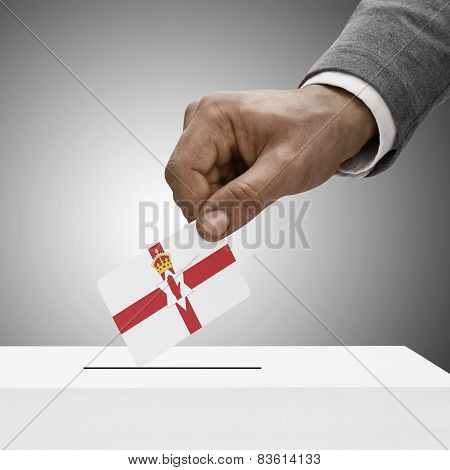 Black Male Holding Flag. Voting Concept - Northern Ireland