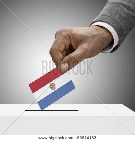 Black Male Holding Flag. Voting Concept - Paraguay