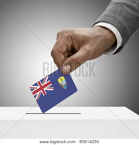 Black Male Holding Flag. Voting Concept - Saint Helena