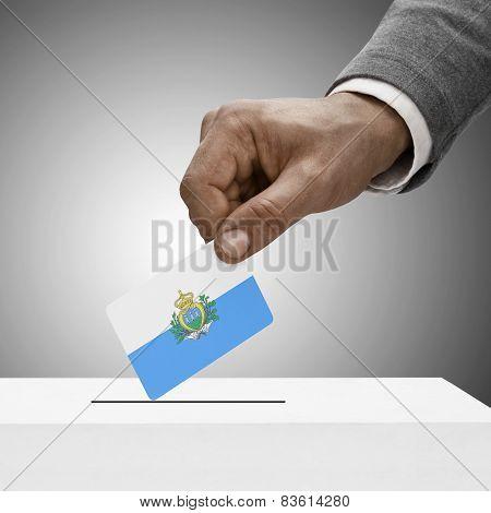 Black Male Holding Flag. Voting Concept - San Marino