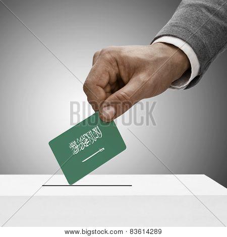 Black Male Holding Flag. Voting Concept - Saudi Arabia