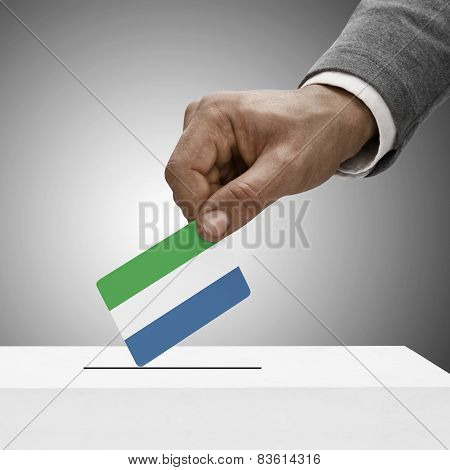 Black Male Holding Flag. Voting Concept - Sierra Leone