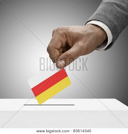 Black Male Holding Flag. Voting Concept - South Ossetia