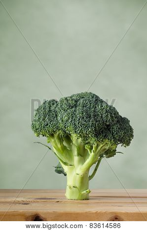 Broccoli On Wood With Green Background
