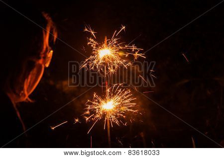 Burning Sparklers And A Girl With Glasses From Close