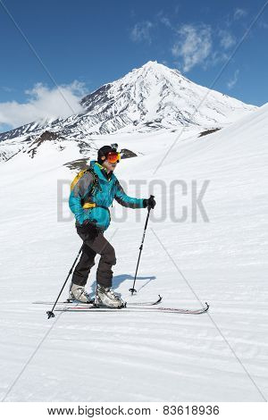 Ski Mountaineer Climb On Skis On Background Volcano