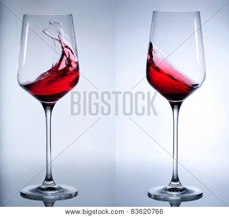 Red wine splashing in the elegant glass.