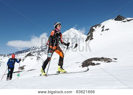 Ski mountaineering Championships: ski mountaineer climb on skis on background volcano