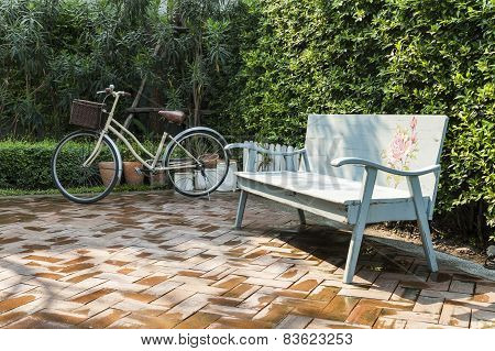 Vintage Bench And Bicycle In Garden
