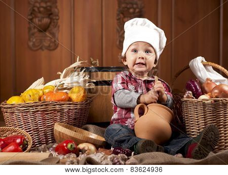 baby in a cook cap