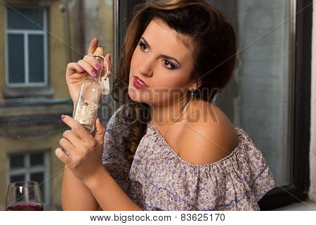 Beautiful Woman With Message In A Bottle