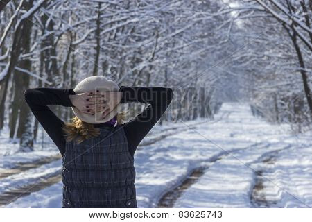 Woman Contemplating The Forest In Winter Time