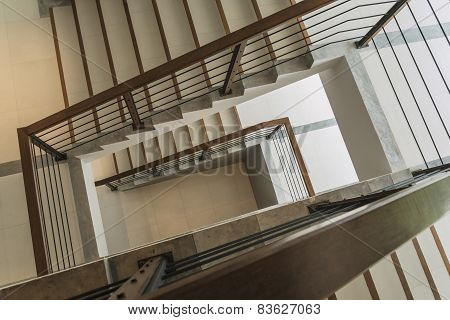 Staircase With Wooden Rail In A Modern Building
