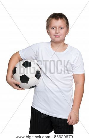 Confident Young Boy With Soccer Ball