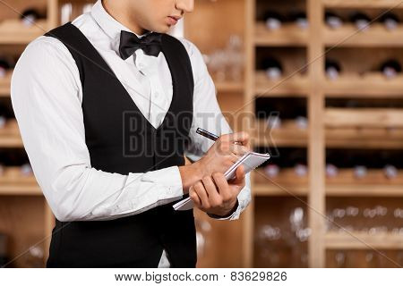 Checking Wine List.