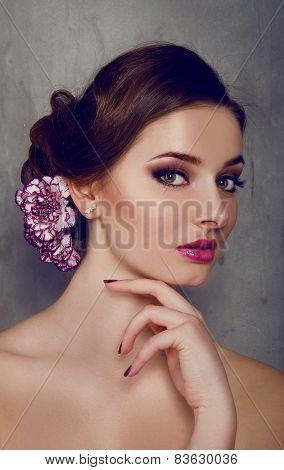 Beautiful Woman With Carnation Flower In Her Hair