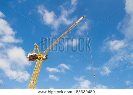 yellow crane in blue clear sky
