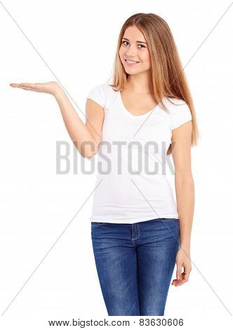 Happy Young Woman In Tshirt Showing Empty Copyspace
