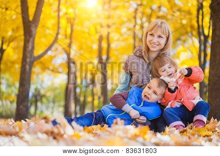 family have fun in the autumn park
