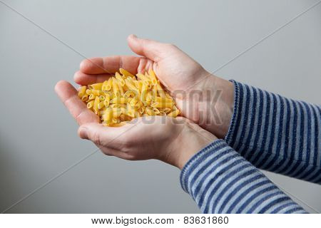 Woman Holding Raw Noodles In Her Hands