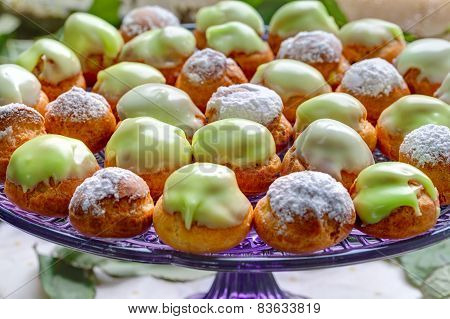 vivid profiteroles on glass tray