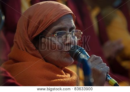 Woman Sings A Prayer On Ganga Aarti Ceremony In Parmarth Niketan Ashram