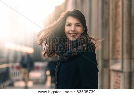 Happy Woman With A Lovely Smile On A Winter Street