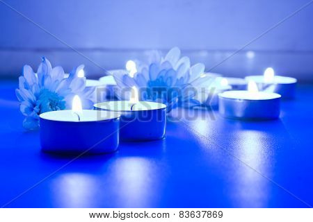 Blue flower and tea candles