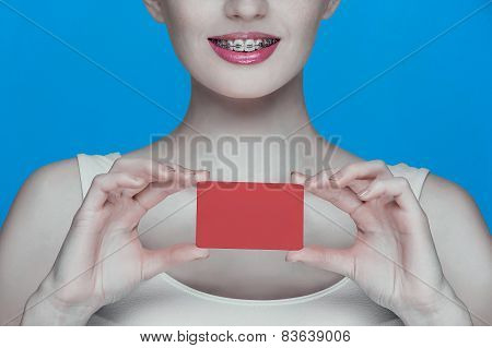 Beautiful Girl With Braces And Red Card In Hands