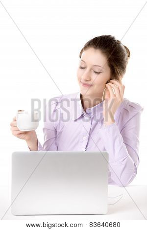 Young Woman Enjoying Music With Cup Of Coffee In Front Of Computer