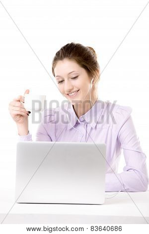 Young Woman Relaxing With Cup Of Coffee In Front Of Laptop
